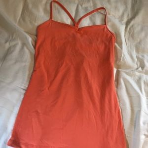 Orange Lucy brand workout tank with built in bra